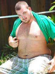 Chubby dude Hunter posing outdoors